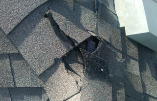 Roof Damaged by Hail Storm